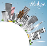 Abidjan Skyline with Gray Buildings, Blue Sky and Copy Space. Royalty Free Stock Photo