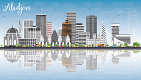 Abidjan Skyline with Gray Buildings, Blue Sky and Reflections. Royalty Free Stock Photography