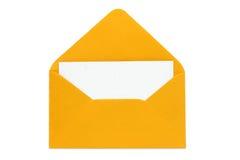 Abierto de la naranja envuelto con la tarjeta en blanco Imágenes de archivo libres de regalías