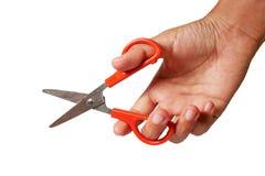 Abierto scissor en la mano humana aislada en blanco Imágenes de archivo libres de regalías