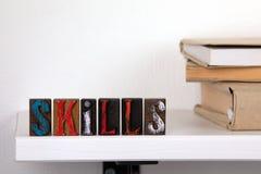 Abilità - parola dalle lettere di legno colorate immagini stock