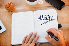 Ability against man writing notes on diary Royalty Free Stock Photos