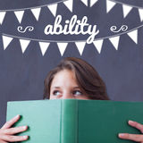 Ability against student holding book Royalty Free Stock Photo