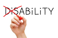 Ability Not Disability. Hand turning the word Disability into Ability with red marker isolated on white Royalty Free Stock Images