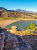 Abiquiu Lake and Cerro Pedernal in New Mexico. Blue sky above Abiquiu Lake and the mountains in northern New Mexico. Cerro Pedernal, a flat topped mountain stock photography
