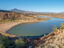 Abiquiu Lake and Cerro Pedernal in New Mexico. Blue sky above Abiquiu Lake and the mountains in northern New Mexico. Cerro Pedernal, a flat topped mountain stock photos