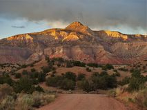 Abiquiu, New Mexico. Sunset in the mountains new Abiquiu, New Mexico royalty free stock image