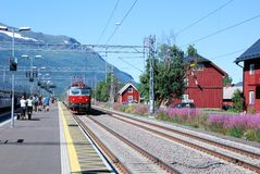 Abisko �stra small train station with arriving train, Sweden Stock Image