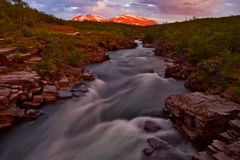 Abisko national park. Midnight sun on 11 at night, the river flowing through park abisko in sweden Royalty Free Stock Image