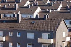 Abitazione ad alta densità urbana delle particelle elementari del condominio Immagini Stock