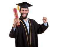 Abito laureato e cappuccio d'uso dello studente isolati su fondo bianco Fotografie Stock