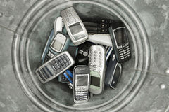 Abjected cellphones. In a basket Stock Photo