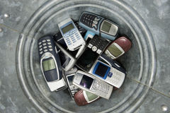 Abjected cellphones. Several Abjected cellphones in a basket Stock Photography