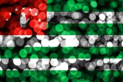 Abkhazia abstract blurry bokeh flag. Christmas, New Year and National day concept flag.  royalty free illustration