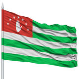 Abkhazia Flag on Flagpole. Flying in the Wind, Isolated on White Background Royalty Free Stock Photos