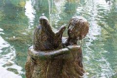 Abkhazia, New Athos monument: a boy hugs fish. Fountain Royalty Free Stock Image