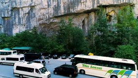 Abkhazia, Yupshar gorge August 9, 2019 tour bus Stop in the canyon. Panorama of the minibus. People are photographed stock video footage