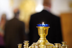 Ablaze candle during church service Stock Image