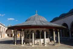Ablution fountain. Usually polygonal planar conical roofed water structure used to take ablution in the mosque Stock Photography