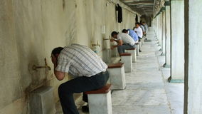 Ablution in a historical mosque stock video footage