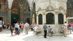 Ablution in a historical mosque stock footage