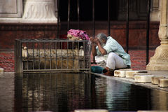 Ablutions. Delhi, India - December 26,  2014: Man performing ritual muslim ablutions at Mosque, Jama Masjid Stock Photos