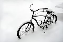 Abnormal weather. Bad weather in winter. Bike in the snow. Lonely bicycle covered with snow. Bike buried in snow. First snow. royalty free stock image