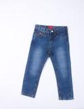 Abnutzung der Kinder Kinderkleidung auf Hintergrund Abnutzung der Kinder lizenzfreie stockbilder