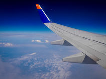 Aboard on a flight over the clouds Royalty Free Stock Photography