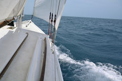 Aboard a sailboat on the sea Royalty Free Stock Photos