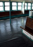 Aboard the ship -- Empty Staten Island Ferry in use in New York City. Old deck still in use in New York City stock photos