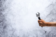 Abolish child labour! Dirty child hand with wrench Royalty Free Stock Images