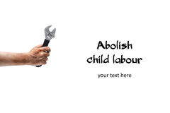 Abolish child labour! Dirty child hand with wrench. Isolated on white. Horizontal Royalty Free Stock Photography