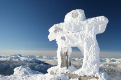Abominable Snowman. A rime covered Inuksuk greets visitors to the Whistler Valley royalty free stock image