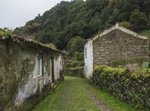 Abondoned ghost town houses, small village of Faial da Terra to Sanguinho in rainforest, Sao Miguel Island, Azores. Portugal stock photography