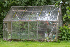 Abondoned greenhouse. An abondoned glass greenhouse in a park Royalty Free Stock Photos