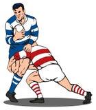 Aborder de joueur de rugby Photographie stock libre de droits