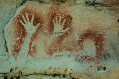 Aboriginal Art Carnarvon Gorge. Stencils by aboriginal people several thousands of years old. Hands Royalty Free Stock Photo