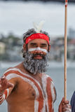 Aboriginal Australian man in Sydney. SYDNEY,AUSTRALIA - NOVEMBER 22,2015: An indigenous dancer waits his turn in a competition at the Homeground festival - a royalty free stock photo
