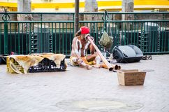 Aboriginal Australian musician street shows playing `Didgeridoo` is a wind instrument developed by Indigenous people. SYDNEY, AUSTRALIA. – On December 19 Stock Image