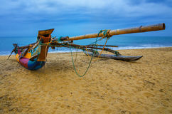 Aboriginal boat on the sandy shores Royalty Free Stock Image