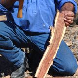 Aboriginal building a boomerang. Flinders Rangers National Park, Australia - February 09, 2002: Building a boomerang in the outback Royalty Free Stock Image