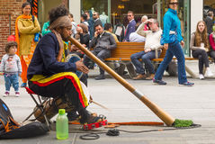 Australian Aboriginal busker. Adelaide, Australia - November 12, 2016: Rundle Mall, located in Adelaide`s city center, is a popular place for shopping and also Stock Image