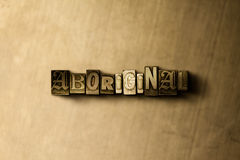 ABORIGINAL - close-up of grungy vintage typeset word on metal backdrop Stock Image