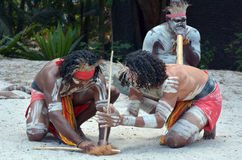 Aboriginal culture show in Queensland Australia. Group of Yugambeh Aboriginal warriors men demonstrate fire making craft during Aboriginal culture show in Royalty Free Stock Photography