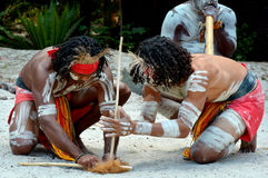 Aboriginal culture show in Queensland Australia. Group of Yugambeh Aboriginal warriors men demonstrate  fire making craft during Aboriginal culture show in Stock Image