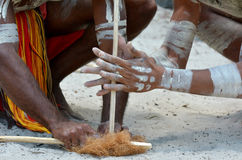 Aboriginal culture show in Queensland Australia. Hands of Yugambeh Aboriginal warriors men demonstrate fire making craft during Aboriginal culture show in royalty free stock photos