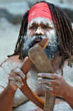 Aboriginal culture show in Queensland Australia. Portrait of one Yugambeh Aboriginal man holds boomerangs and sing during Aboriginal culture show in Queensland Stock Photography