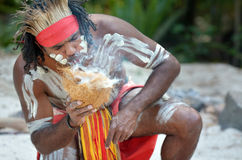 Aboriginal culture show in Queensland Australia. Portrait of one Yugambeh Aboriginal warrior demonstrate fire making craft during Aboriginal culture show in stock photo
