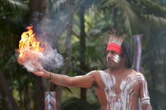 Aboriginal culture show in Queensland Australia. Portrait of one Yugambeh Aboriginal warrior demonstrate  fire making craft during Aboriginal culture show in Stock Image